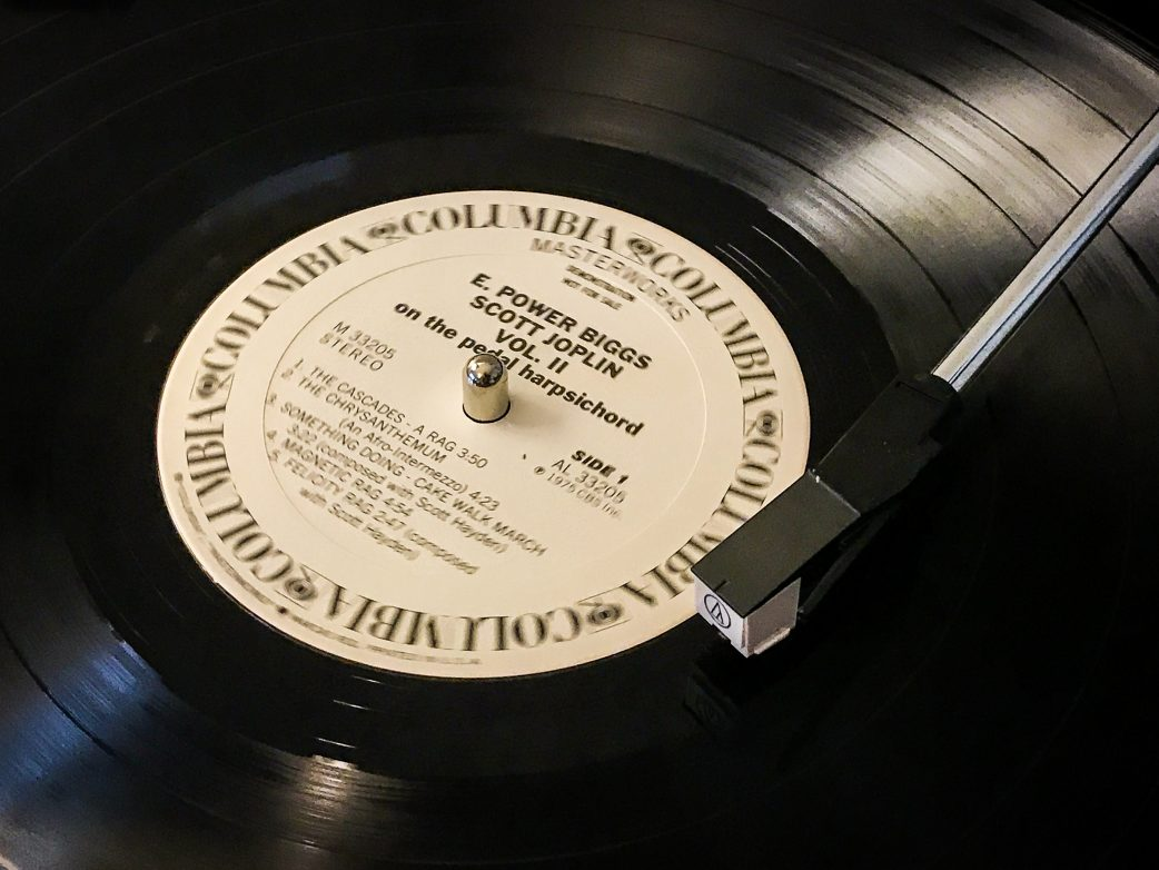 Close-up of vinyl record playing on turntable.